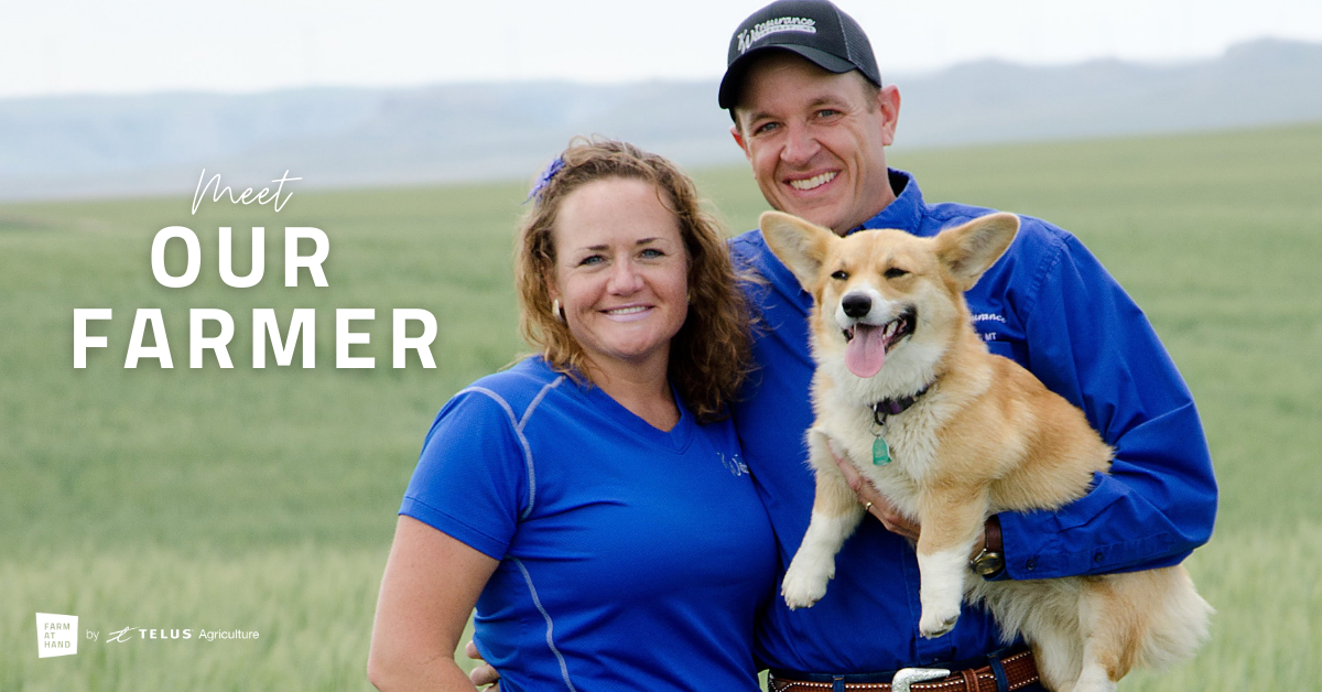 two farmers holding corgi dog